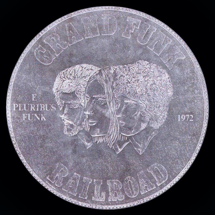 """5 E Pluribus Funk, de 1971, conhecido como o """"disco da moeda"""", é certamente o álbum mais """"redondo"""" do Grand Funk Railroad."""
