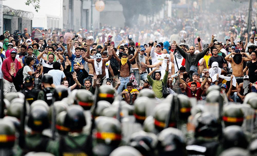 Manifestação na Venezuela, onde negociou com Hugo Chávez e a oposição