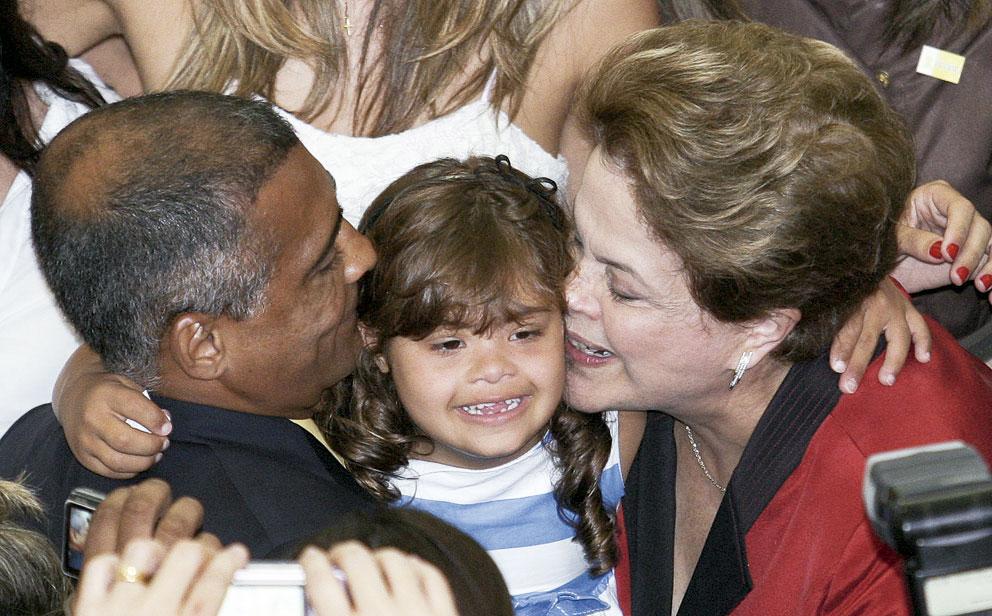 Com a filha, Ivy, e a presidente Dilma Rousseff
