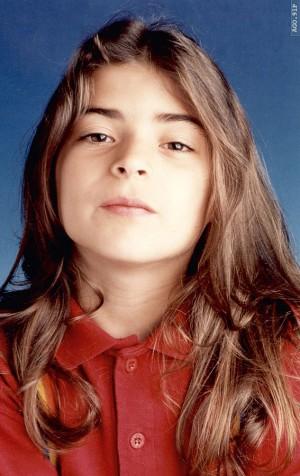 Fazendo pose para o pai, o fotógrafo Luís Vellez, aos 9