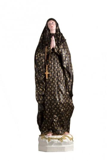 A imagem da santa em Louis Vuitton