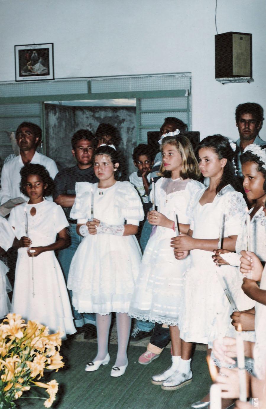 Na primeira comunhão,  aos 13 anos