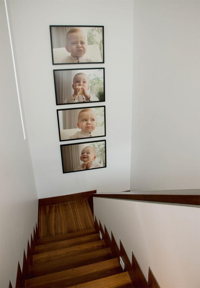 Caras e bocas  O corredor que leva à área íntima tem fotos da filha Roberta, clicadas pelo fotógrafo Edu Campos