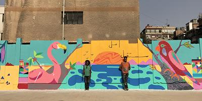 Brasileiros pintam o maior mural de arte de rua da Síria