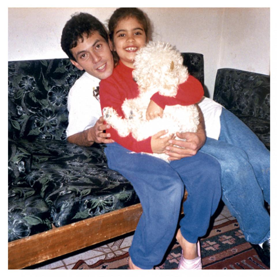 Com o pai, Olionaldo, em 2000, aos 7 anos