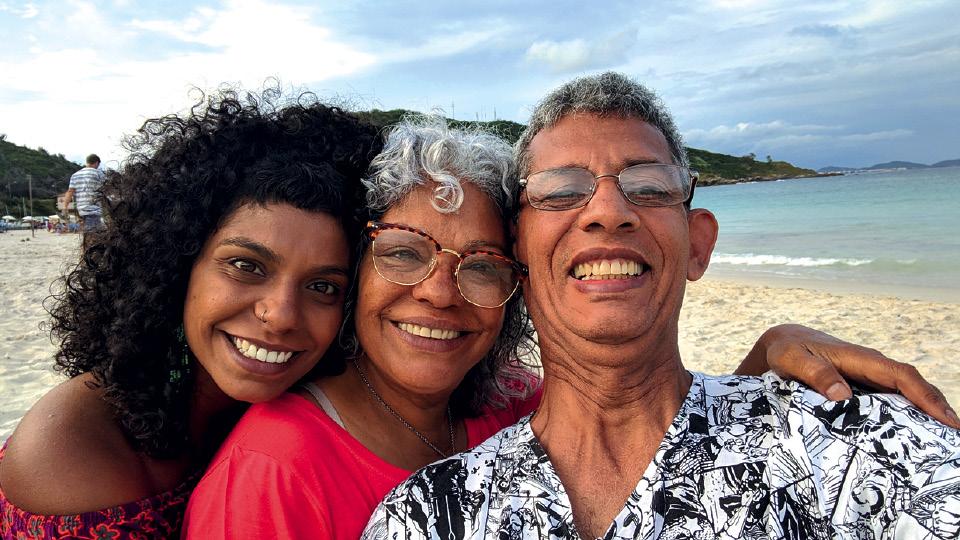 Chris com os pais